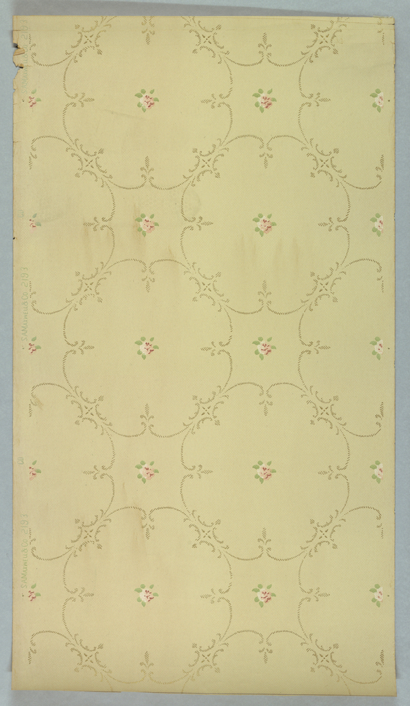 Roughly circular shapes composed of scrolls made of dashed lines, floral motif in the center of each. Printed on light ground.