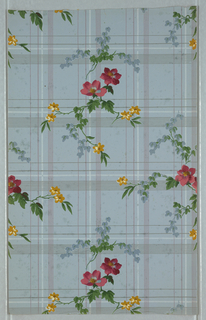 Plaid ground overlaid with flowering branches. Printed in blue, bright pink, dark pink, green and dark yellow on a blue ground.