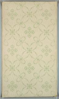 Foliate quatrefoil shapes forming a trellis pattern. Printed on background of zig-zag stripes.
