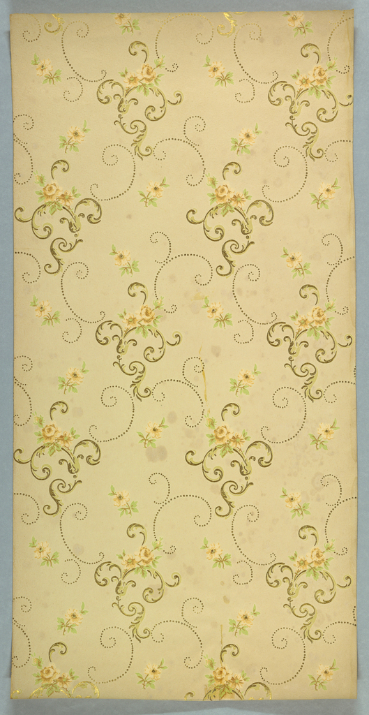 Scrolling acanthus ornaments with floral sprigs, linked by dotted scrolls. Printed in yellow, green, brown, and metallic gold on light ground. No selvedge on either side.