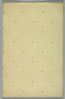 Dotted lines form a framework of eight-pointed stars, with a floral motif in the center, that  alternates with quatrefoil shapes. Printed in yellow, green, and gray on light colored background.
