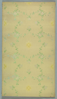 Small round yellow motif having quilted or tufted effect surrounded by circle of vining foliage. Printed on background patterned with very small grid or tufting.