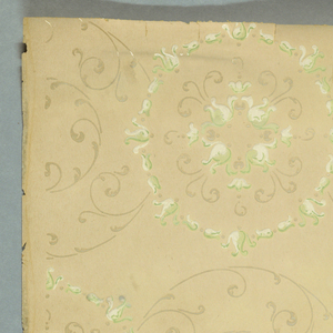 Horizontal rows of overlapping circles composed of open, foliate scrollwork. Circles alternate between thin, delicate line work and heavier foliate detailing. Pattern printed in beige, white and light green on khaki ground.