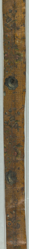 Diapered field, varnished silver. Rococo vine, in green, with flowers in red and blue.