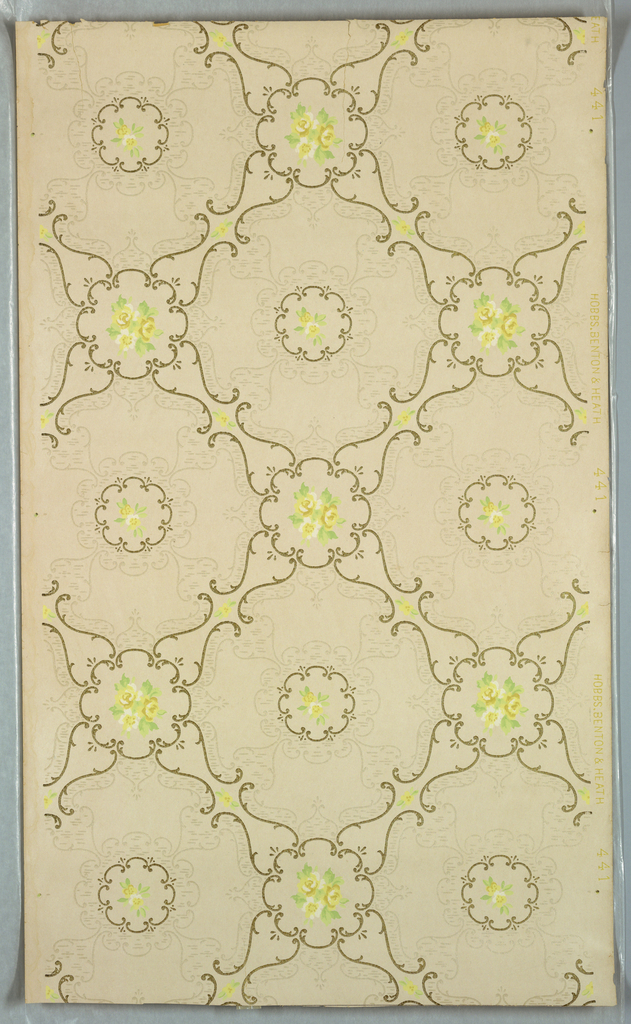 Grid or trellis pattern formed with S scrolls, with circular shaped at intersection composed of C scrolls with floral motif in center. Smaller C scroll circular shape centered in each void. Printed on off-white ground.