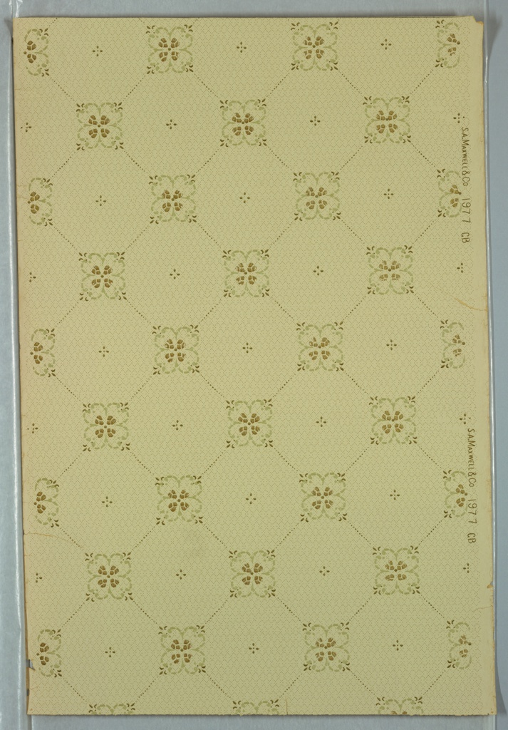 Trellis pattern with quatrefoil shape at intersections. Printed on light green ground.