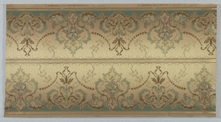 On gradient cream and beige ground, alternating tall and short arabesque scroll motifs in sea green, white, and brown. Two borders printed across the width.