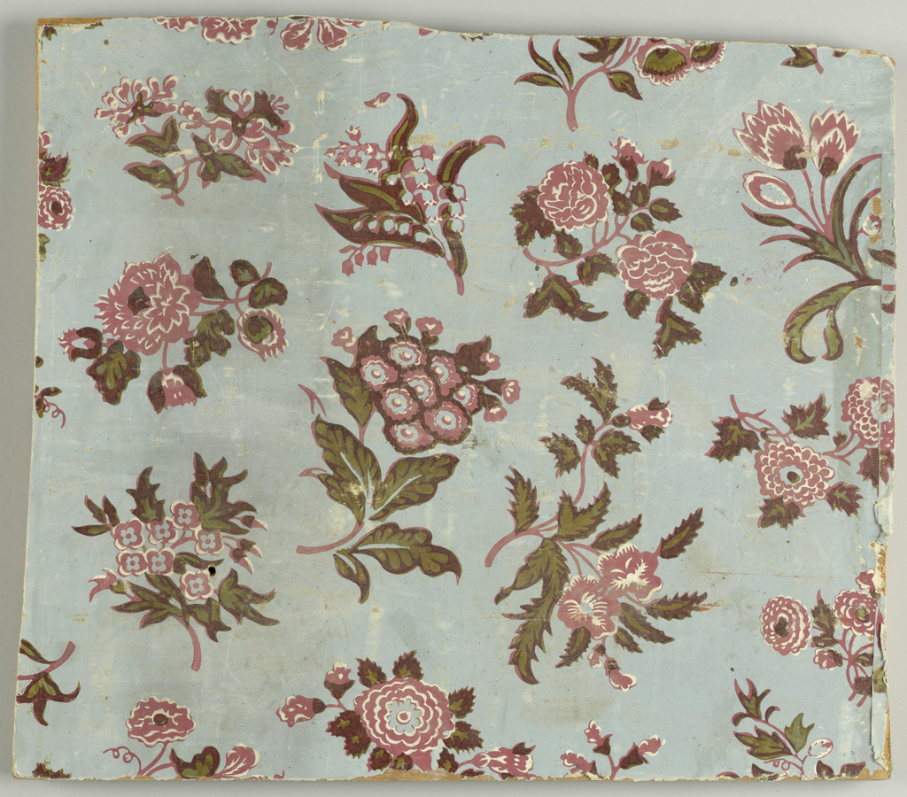 Variety of flowers, including roses and lily of the valley, printed in red and white with green leaves. Printed on light gray ground.