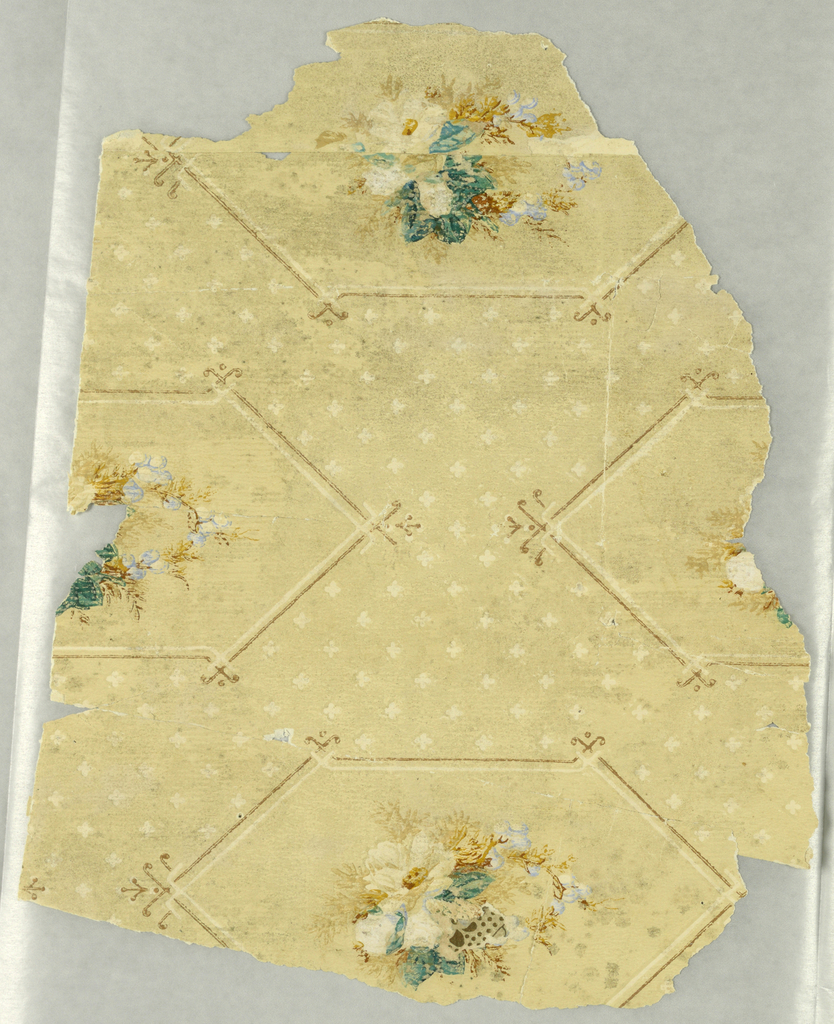 Small multicolor floral bouquet within diamond-like medallion, on beige ground printed with tiny white quatrefoils.
