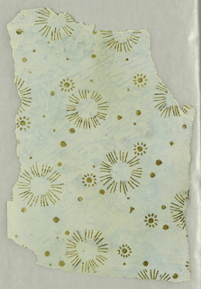 Starburst or dandelion-like flowers with smaller floral-like motifs and dots. Printed in metallic gold on light blue ground.
