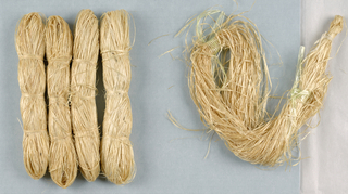 Five skeins of honeysuckle bark, used in making grasscloth wallpaper.