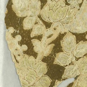 All-over floral pattern, with several varieties of flowers, printed in beige on dark brown ground.