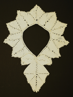 Passementerie for a collar. Fine white muslin ribbon strips, stitched together in a leaf-like pattern in the form of a serrated collar with front diamond shaped medallion and bow. 1930s.