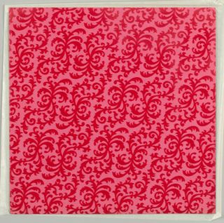 One of nine wallpaper squares; small repeating design of foliate tracery, in red flocking on pink ground; heavy paper.