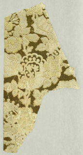 All-over floral pattern, with several varieties of flowers, printed in beige on dark brown ground.