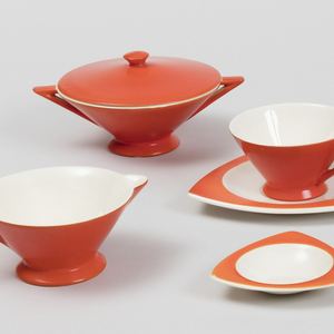 Inverted cone-shaped bowl (a) on short circular foot with two triangular handles; circular lid (b) with round knop at top center; red-orange exterior.