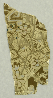 In the Aesthetic style, stylized plant and floral motifs with geometric divisions, printed in tans, browns and gray.