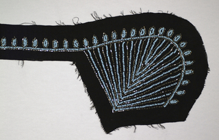 Panel for a collar. Striated fan design, beaded with turquoise seed beads and hematite bugle beads, on black crepe ground.
