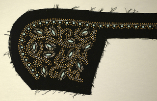 Panel for a collar. Scrolling foliate design, beaded with turquoise and matte gold seed beads, hematite bugle beads, faceted steel beads, and turquoise enameled studs, on black crepe ground.