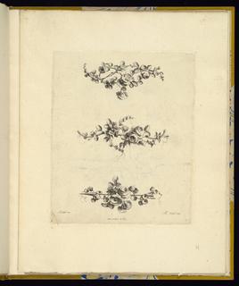 Three varying decorative flower motifs