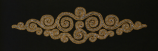 Scrolling swirls in oblong diamond shape, beaded with matte copper beads and faceted steel beads, on black crepe ground. 1940s.