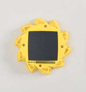 LED lamp in the shape of a sun with ten petal components and backed with a solar panel