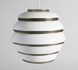 Beehive-shaped hanging lamp, the structure consisitng of five horizonal, wide, white-enameled metal bands alternating with narrow pierced brass bands; white cord at center top.