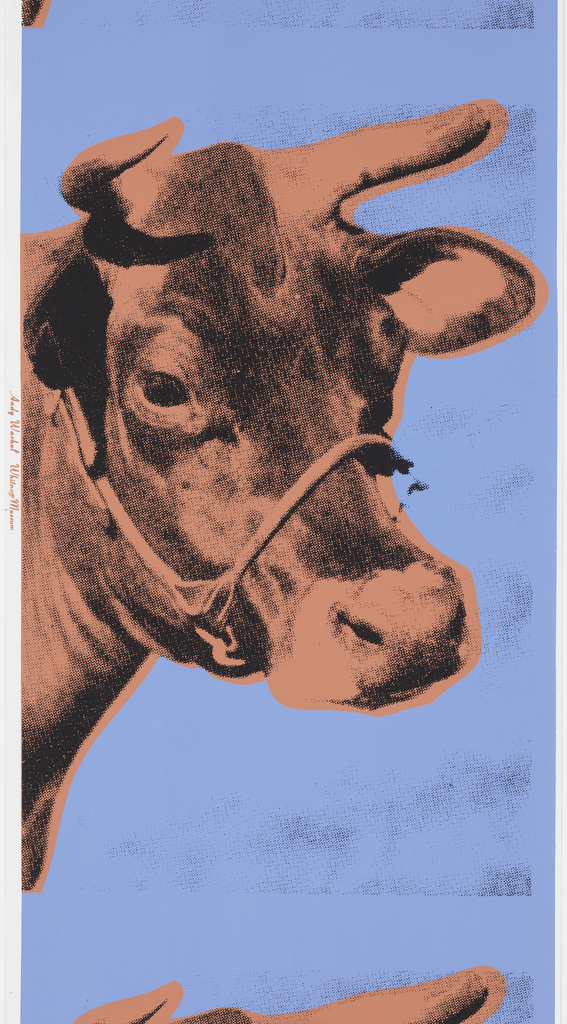 In photographic half-tone enlargement, the head of cow in twice-life-size dimensions. Design is repeated vertically. Printed in coral and black on deep blue background.