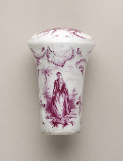 Porcelain cane handles painted in pink of both male and female figures. On the top of the handle, a painted female sits in an outdoor scene.