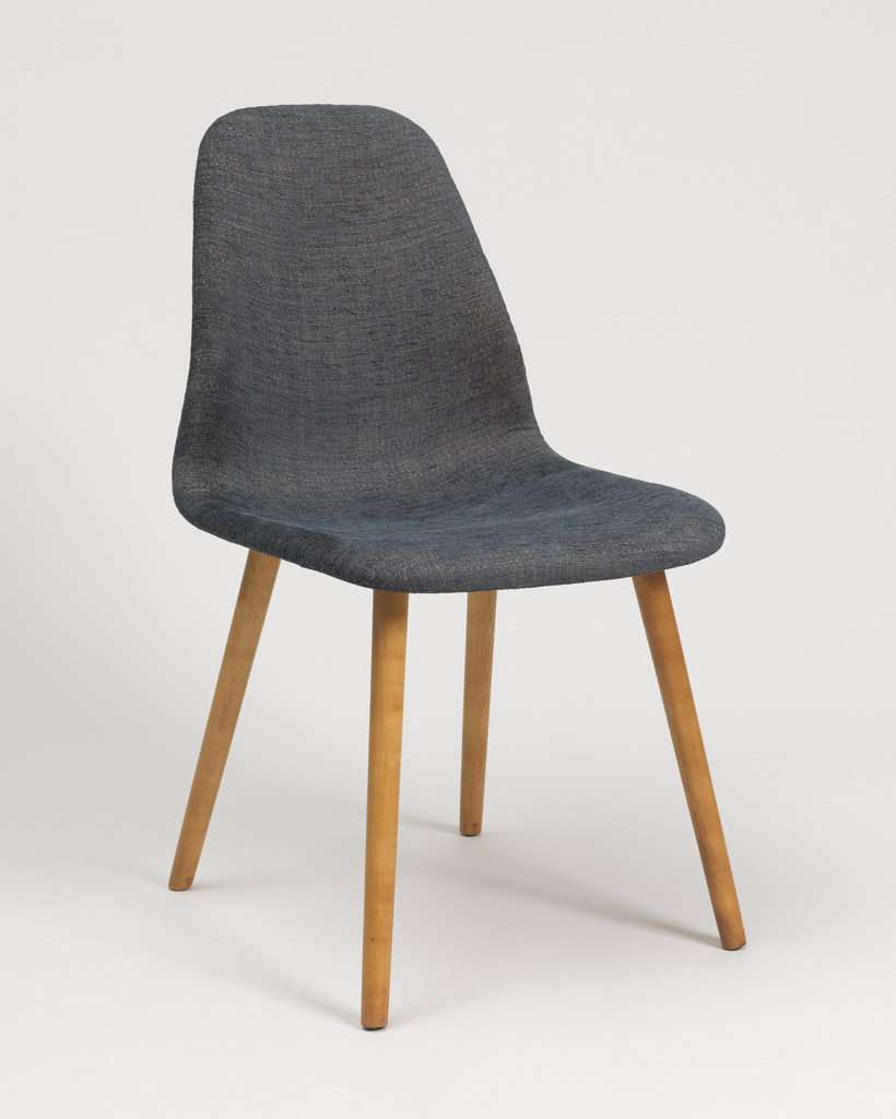 Contoured, molded wood seat/back unit on four thin cylindrical wooden legs; upholstery on seat/back.