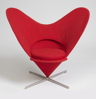 Chair of inverted cone shape, the back curved to form a heart-shape, the whole upholstered in bright red woven wool, and mounted on a horizontal X-form steel base.