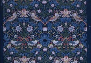 Vertically symmetrical arrangement of pairs of confronted and addorsed birds, with strawberries and flowers. Printed in several colors on a dark blue ground.