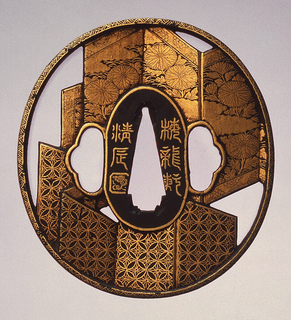 This Kenji style tsuba is naga maru (round) in shape and has a gilded mimi kaku koniku (a square rim with slight rounding). The decoration uses maru bori (round surface carving) with nunome kin zogan (an inlay of gold leaf affixed to a serrated ground), and shows byō bu issō (a pair of folding screens) with patterns.   At the center is the nakago-ana, an opening through which the sword passes. Surrounding this is the seppadai, a flat oval area that is migaki (burnished) and rimmed in gold. On either side are ryō-hitsu openings, both of the suhama type, symbolically represents the coastline of Horai, the holy island of the Immortals.