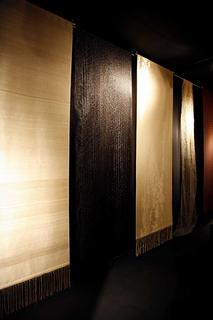 Handwoven black nylon and copper panel.