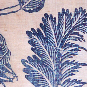 Fragment in two shades of blue on a white ground. Design of undulating branches with large cup-shaped blossoms and curling leaves with pendant fruit. Much use of fine lines and dots to enhance design.