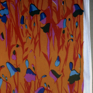 Printed in orange, red, pink, turquoise, olive green, and violet.  Design of all-over stylized tulip elements.