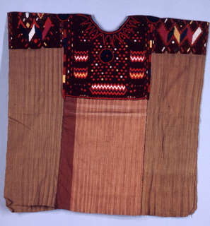 Three lengths of natural brown coarse cotton sewn together with coarse black cotton thread. Elaborately patterned in geometric designs over the shoulders and down both front and back, in bright polychrome wool, mostly orange. Four rosettes of black rayon set into pattern. Most likely synthetic dyes. Abstract design on the central panel represents the double-headed eagle.