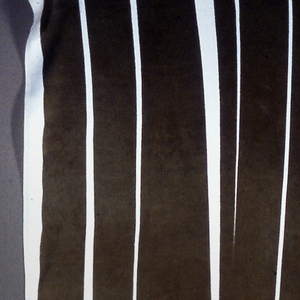 Printed in olive green against white background.  Design shows stripes of various widths growing out of elongated undulating shapes.