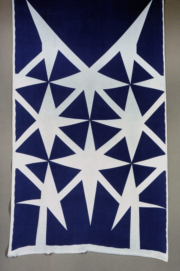 Printed in purple, assimilating the original silk background color of grey.  Pattern shows large stylized star shapes.