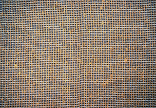 Sample of casement cloth woven of dark orange wool and gold metallic thread.