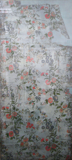 Ascending serpentine design of vine tendrils and flowering branches. Two repeats to the width in drop-repeating relationship. Orange, pink, blue and white flowers, green leaves and stems with black outlines. Printed in ouline with forms (blocks?) and stencils, on linen ground. Floral patterned wachstuch or wax cloth.