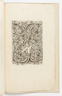 Vertical rectangle completely filled with scrolling, interlacing arabesques. At bottom, a figure whose bodies terminate in acanthus leaves holds a flower in his right hand.