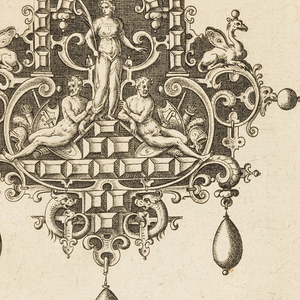 A pendant suspended from a ribbon with a bow knot. Strapwork forms a cartouche with three drop pearls. At center stands Ceres with wheat, flanked by seated male nudes with trophies.