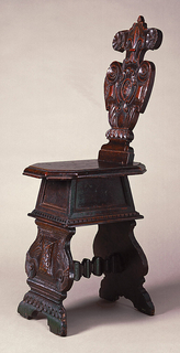 Shaped back bears decoration of paired rosettes, leaves, and scrolls centering a fleur-de-lys and heraldic ornament. Moulded octagonal seat on panelled spreading box frame, moulded and dentillated at base. Front and rear leg panels joined by single stretcher. The front panel bears paired bound and scrolled leaves and centers a panel of feathering.