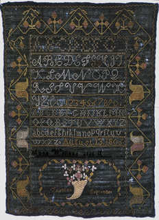 Bands of alphabets and numerals, date and inscription, and a cornucopia of flowers in an oval framework with Taunton, September. Enclosed on three sides by stylized floral border, and on the fourth by a Greek fret border. Embroidered in colored silks on a black ground.