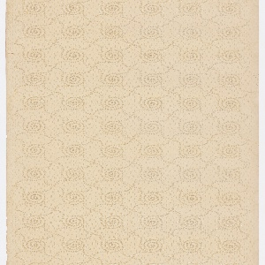 """Repeating spiral motif, with four """"legs"""" that connect to other spirals. Printed in brown and mica on tan ground."""