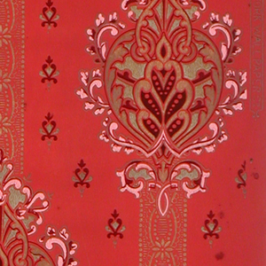 Large-scale foliate medallion on stripe pattern. Small medallion motifs fill the background. Printed in metallic gold, pink, and red on red ground.