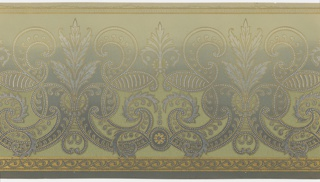 Large wave scrolls with large leaves (acanthus), beading and striping. Bottom band of wave pattern and beading. Top has band of stylized dentil pattern with dots. Part of background willed with light green. Ground embossed with floral vining and shades dark blue-green to light green (bottom to top). Printed in metallic gold, metallic silver and light green.