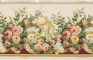 Flitter frieze with bouquets of large roses, red and yellow, alternating with acanthus scrolls. All the motifs are outlined in gold mica flakes. Printed on a yellow ground.