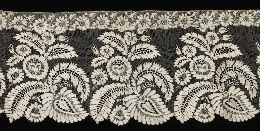 Lace showing a pattern of sprays of flowers and leaves that form a border on one edge and conventionalized flowers and leaves on the other.